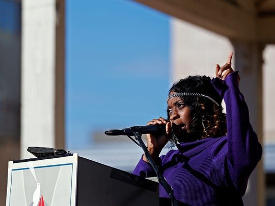Kaijuanda Sutton speaks to attendees during the rally