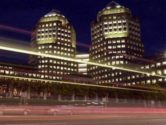 635599355892085824-P-G-towers-getty-images-at-night-with-cars-whizzing-by-2001