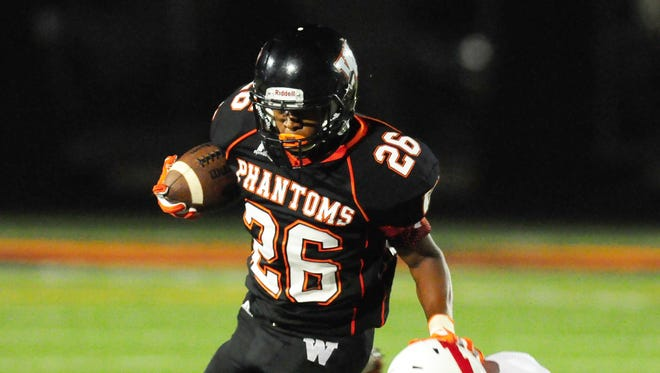 West De Pere running back Dom Conway turns the corner against Seymour's Clayton VanLanen.