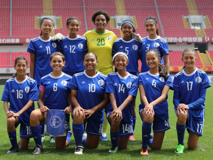 Guam's starting 11 players pose for a photo ahead of