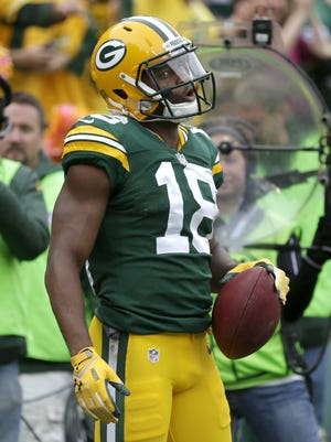 Green Bay Packers wide receiver Randall Cobb celebrates his touchdown reception in the second quarter against the Carolina Panthers.  The Green Bay Packers host the Carolina Panthers Sunday, October 19, 2014, at Lambeau Field in Green Bay, Wis.  Wm. Glasheen/Post-Crescent Media