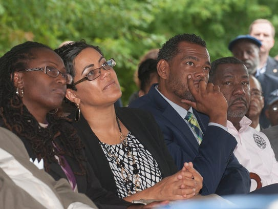 Camden residents listen to U.S. Rep. John Lewis, during