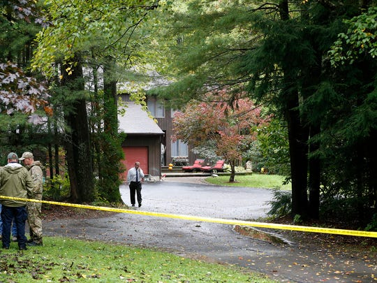 Police investigate at the residence of Thomas and Kelley Clayton on Sept. 30, the day after Kelley was found unresponsive in the Ginnan Road home.