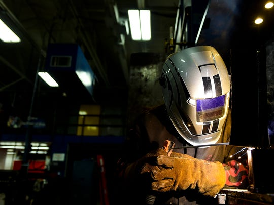 Andrea DePolo works on a piece of metal during welding class at Tri-Rivers Career Center in 2016. Tri-Rivers offers programs to help prepare youth and adults for the workforce, which in Marion County has not recovered to pre-recession levels.