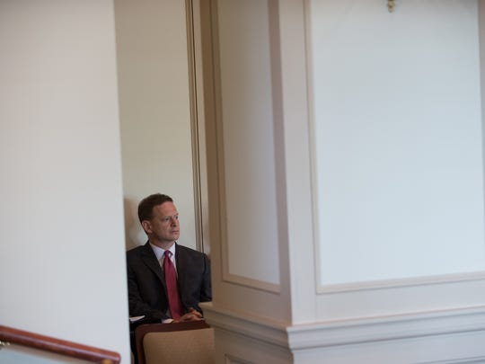 Attorney General Matt Denn listens during the presentation by Paul H. Robinson, a University of Pennsylvania professor, concerning rewriting the state's criminal code during a meeting of the Joint Finance Committee on Wednesday, June 8, 2016. Denn said he opposed the effort from the start, and his prosecutors have not participated in it.