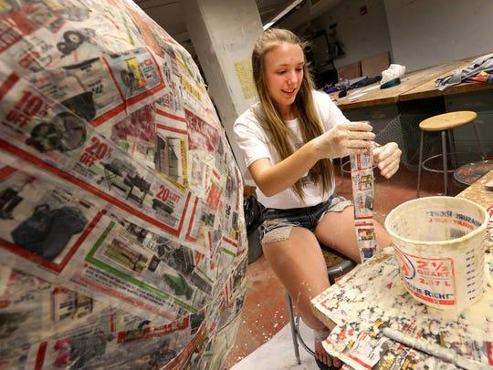 Sarah Kellon, of Arlington High School, creates a large