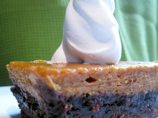 Chocolate Pumpkin Cheesecake Bars can be served with your favorite whipped topping or a scoop of ice cream.