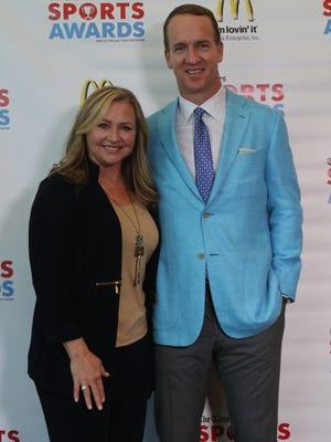 Peyton Manning poses for photos with attendees of a VIP reception during the Shreveport Times Sports Awards at the Shreveport Convention Center in Shreveport, Monday, May 15, 2017.