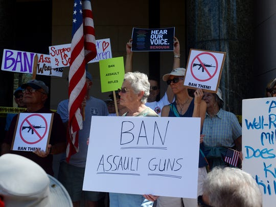 About 150 people gathered on the steps of the Indian River County Courthouse on Wednesday, Feb. 21, 2018 to rally for a ban on assault weapons.