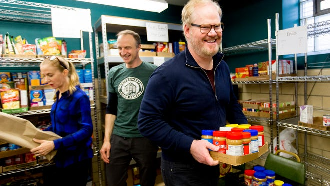 Actor and comedian Jim Gaffigan helps sort food donations at the Riverwest Food Pantry in Milwaukee.