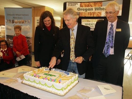 Katy Coba, director of the Oregon Department of Agriculture (from left), Gov. John Kitzhaber and Walter Powell, president of the Oregon Wheat Growers League, cut the birthday cake during Oregon's 154th anniversary of statehood on Valentine's Day in 2013