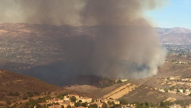 A brush fire broke out in the middle of some homes in the Wood Ranch area of Simi Valley on Tuesday.