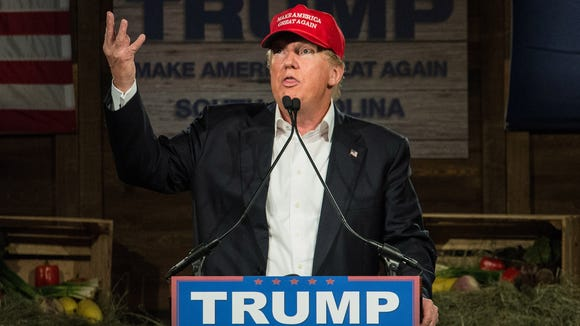 GOP presidential candidate Donald Trump speaks to the crowd at a campaign rally on Wednesday, Jan. 27, 2015 in Gilbert, S.C.