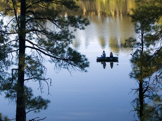 People fish at Fool Hollow Lake Recreation Area in