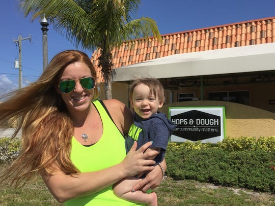Hops & Dough owner Tara Zysset stands with her son