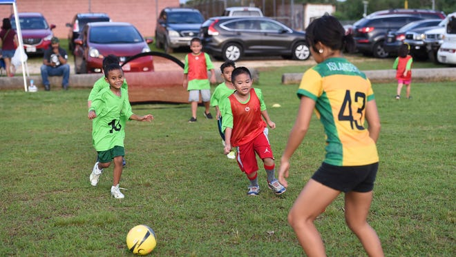 In this file photo, children participate in an E-soccer match at the Dededo Sports Complex.