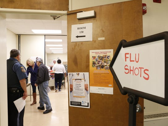 People sign up to receive flu shots at the Rockland