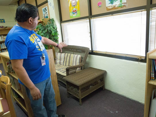 Tommy Esparza, coach and physical education instructor, explains where crews cleaned out mold and repainted after they finished earlier in the week, Wednesday January 224, 2018.
