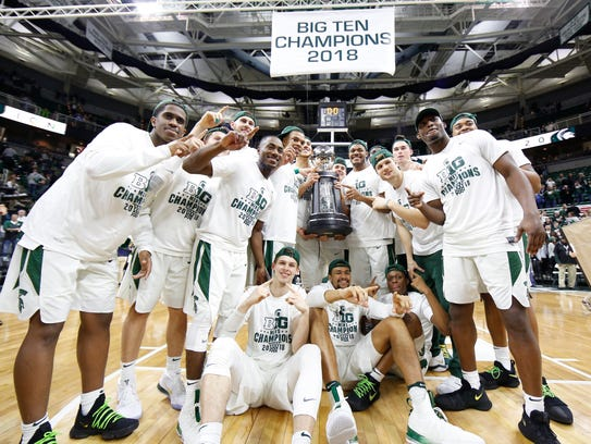 Michigan State celebrates with the Big Ten trophy after