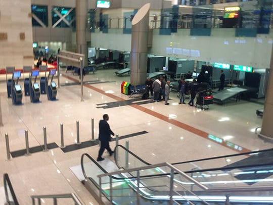Airport staff gather near a security checkpoint at