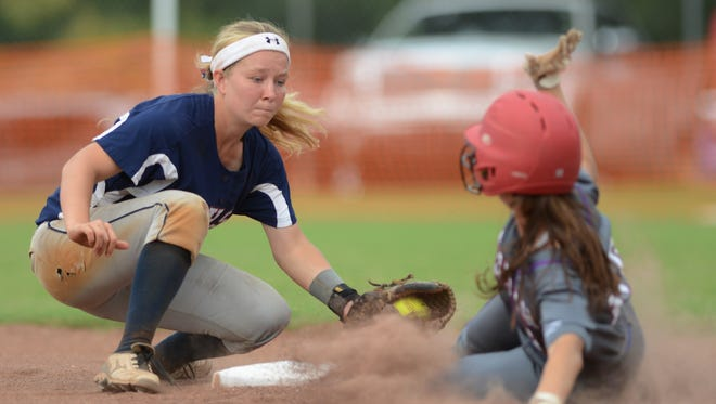Magnolia Heights shortstop Abi Gibson, left, is just late with the tag as Copiah Academy's Kalie Carpenter is safe at second during Monday afternoon's MAIS AAA championship game at Shiloh Park in Brandon.