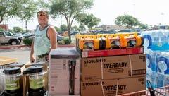Batazar Martinez views the supplies Home Depot set