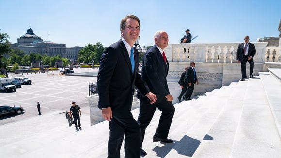 Supreme Court nominee Brett Kavanaugh walks up the U.S. Capitol steps for his first day of meetings with senators Tuesday.