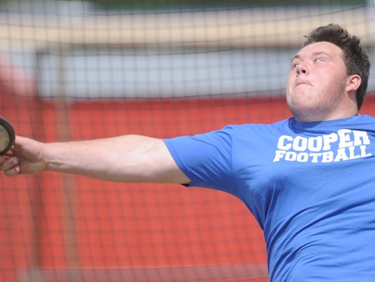 Cooper sophomore McCord Whitaker throws the discus during practice Tuesday at Cooper High School. He goes into the state meet with the sixth-best throw, despite finishing third at the region meet. He earned the lone wild card spot for the event in 5A.