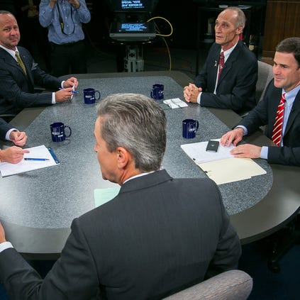 Arizona's candidates for governor await Monday evening's debate. They are (from left) Democrat Fred DuVal, Americans Elect's John Mealer, Libertarian Barry Hess and Republican Doug Ducey. Host Ted Simons (center) moderated at the Channel 8 (KAET) studios in Phoenix.