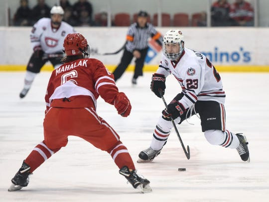 St. Cloud State's Robby Jackson skates with the puck during the first period of the Friday, March 9, game against Miami at the Herb Brooks National Hockey Center in St. Cloud.