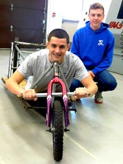 Scott Fairbanks, front, and Dakota Kohler were two competitors in last year's derby race.  The boys worked together to build the vehicle pictured above.