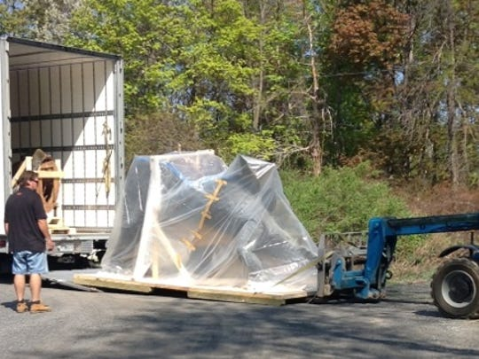 """""""Steggy"""" arrives at the Museum of the Earth in Ithaca Thursday morning."""