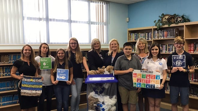 From left, Valerie Gaynor, science teacher coordinator, Jenni Donelon, Ava Robles, Ella Glover, Ginger Featherstone, district deputy superintendent; Laurie Gaylord, superintendent of Martin County schools; Andrew Marini, Anne Ellig, recycling and water conservation coordinator for Stuart, Adriana Mancini Students4H2O founder, and Christopher Carnes are invested in the program.