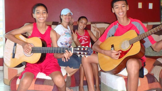 Maria Oyola and her family, from left, Michael Jordan Laboy, Michael's twin sister Genesis and her eldest son Christian, during happier times on the island.