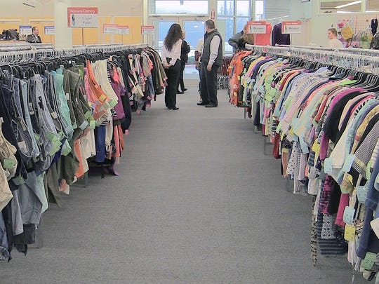 Used clothing fills the racks at the new Salvation Army Family Store that opened in Clemson on Friday.