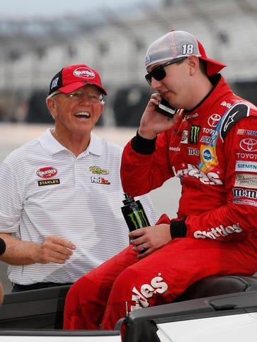 NASCAR Sprint Car driver Kyle Busch takes a phone call