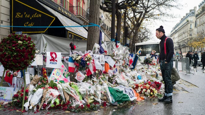 Jesse Hughes, the frontman of the U.S. band Eagles of Death Metal, pays his respects to the victims of the 13th November Attacks in front of the Bataclan in Paris, France, December 8, 2015.