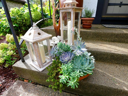 Deb Fowler grouped decorative lanterns and succulents on her porch.