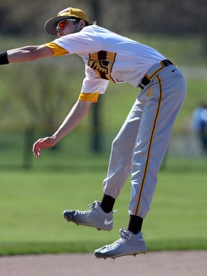 Watchung Hill's  Tyler Kulisz comes down after making a leaping grab of a line drive on April 15, 2016.