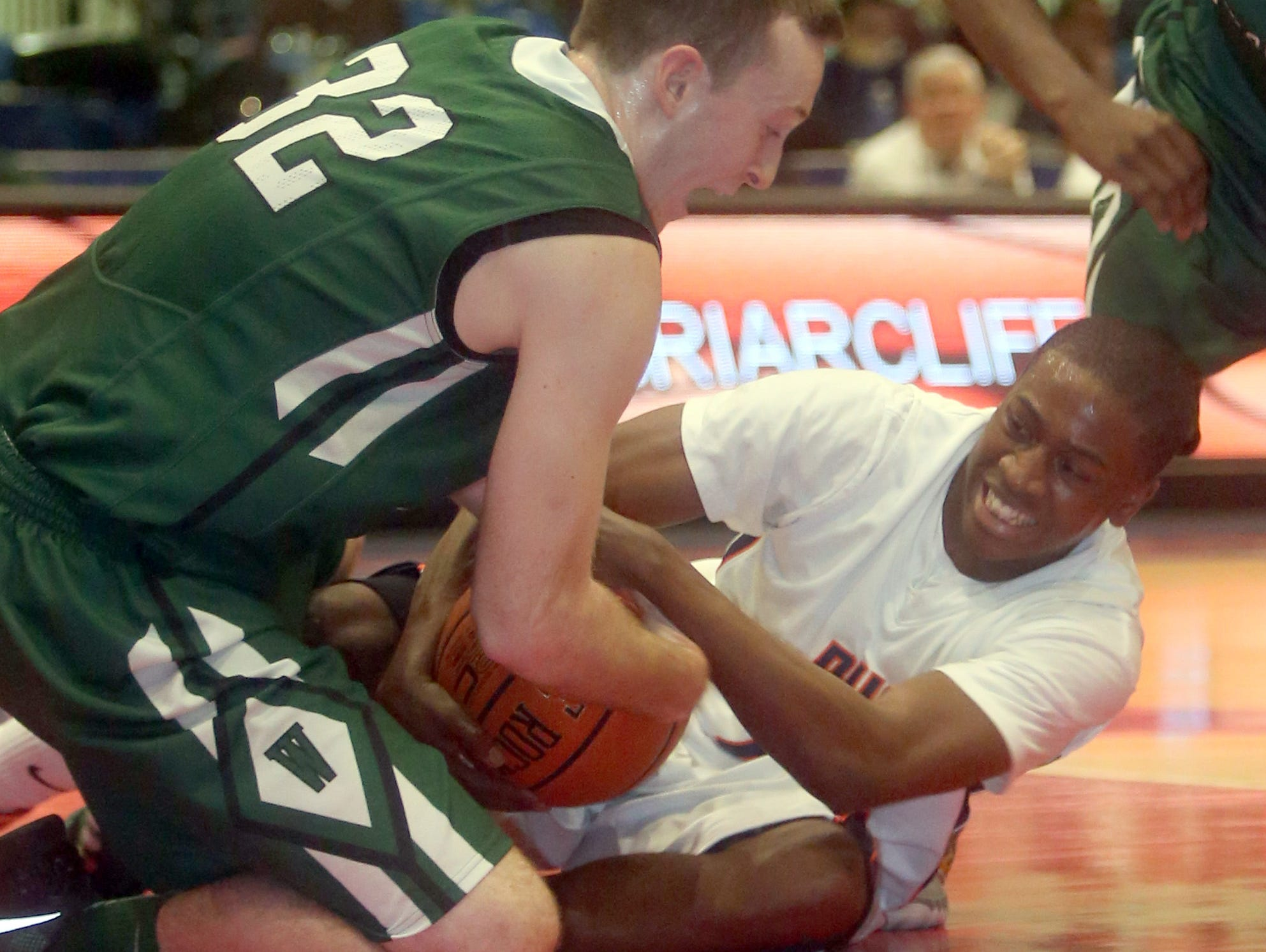 Woodlands' Kyle Smith and Briarcliff's Josiah Cobbs battle for a loose ball during a Section 1 Class B semifinal basketball game at the Westchester County Center in White Plains Feb. 24, 2016. Briarcliff defeated Woodlands 65-56 to advance to the Class B final.