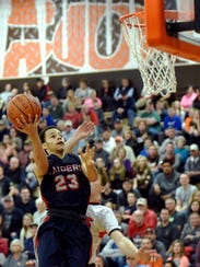 Morgan senior Dre Norman soars for a layup during the