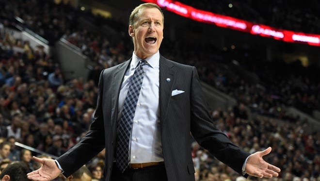 Portland Trail Blazers head coach Terry Stotts reacts to an officials call during the second half of an NBA basketball game against the New Orleans Pelicans in Portland, Ore., Monday, Dec. 14, 2015. The Trail Blazers won 105-101.