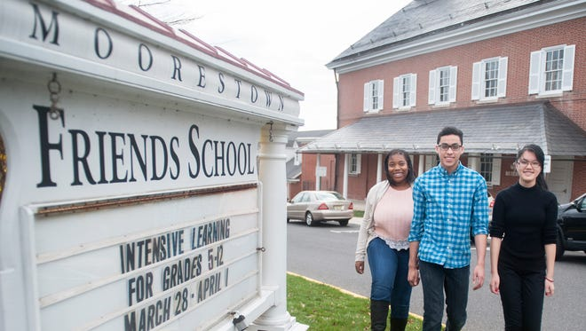 Camden scholars, from left, Siani Lee-Simmons, Moises Cosme, and Han Nguyen attend Moorestown Friends School.  03.31.16