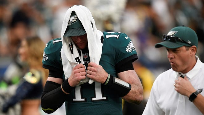 Philadelphia Eagles quarterback Carson Wentz leaves the field during the second half of an NFL football game against the Los Angeles Rams Sunday, Dec. 10, 2017, in Los Angeles.