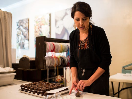 Sophia Bodin packages products at Lolli's Chocolates