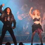 """Jonathan Contreras, left, and Nabil Gonzalez perform in the UTEP Dinner Theatre production of the Tony Award-nominated musical """"Rock of Ages."""""""