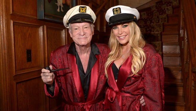 Hugh Hefner and Crystal Hefner attend Playboy Mansion's Annual Halloween Bash at The Playboy Mansion on October 25, 2014, in Los Angeles, Calif.