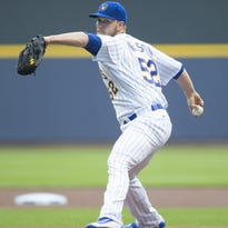Milwaukee Brewers pitcher Jimmy Nelson (52) throws a pitch during the first inning against the Cubs.