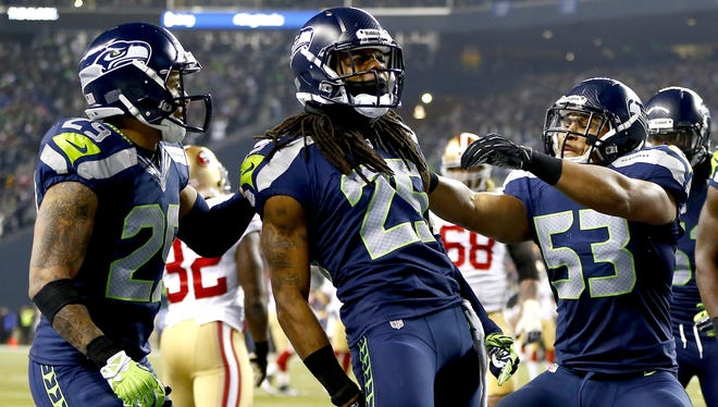 Players from the Seattle Seahawks celebrate as they clinch victory against the San Francisco 49ers.