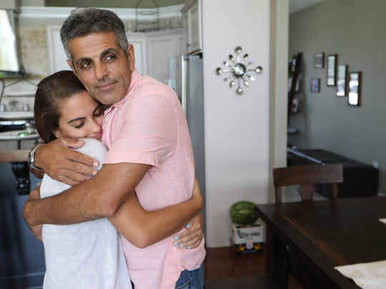 Rudy Blanco hugs his daughter Hannah at the family home in Perry, Fla. as they celebrate his release from ICE detention Thursday, Aug. 31, 2017.